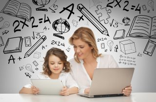 mother and daughter with technology